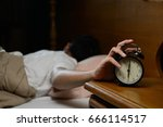 young man turning off the alarm ...   Shutterstock . vector #666114517