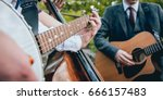 Trio Of Musicians With A Guita...