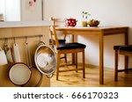 hanging kitchen tools in front... | Shutterstock . vector #666170323