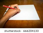 hand is writing a book on the... | Shutterstock . vector #666204133