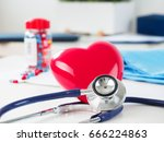 red toy heart and stethoscope... | Shutterstock . vector #666224863