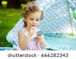 little child draws her lips...   Shutterstock . vector #666282343