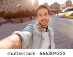 selfie mania  excited young guy ... | Shutterstock . vector #666304333