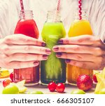 bottles of fruits smoothies... | Shutterstock . vector #666305107