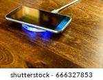 smartphone charging on a... | Shutterstock . vector #666327853