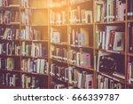 blur books on wooden bookshelf... | Shutterstock . vector #666339787