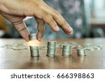 the hand is holding the coin on ... | Shutterstock . vector #666398863