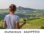 handsome girl holding a glass... | Shutterstock . vector #666499543