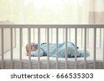 cute little baby sleeping in...