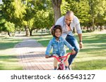 lovely father teaching son... | Shutterstock . vector #666543127