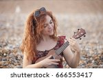 young cheerful woman playing... | Shutterstock . vector #666553417