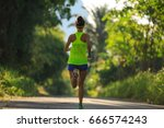 young fitness woman running at... | Shutterstock . vector #666574243