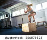 fitness woman jumping on box... | Shutterstock . vector #666579523