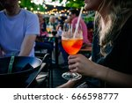 drinking alcoholic cocktail in... | Shutterstock . vector #666598777