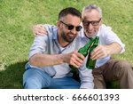 sitting father and adult son... | Shutterstock . vector #666601393