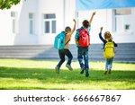 children with rucksacks jumping ...