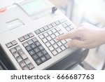 sales person entering amount on ... | Shutterstock . vector #666687763