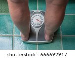 a severely overweight person... | Shutterstock . vector #666692917