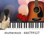 Small photo of Sing along with Two Red Roses Romantic Valentine Love Song by Guitar and piano on bokeh Background.