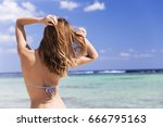 Woman In Swim Suit In Front Of...