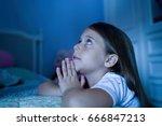girl saying bedtime prayers | Shutterstock . vector #666847213