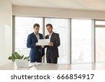 two serious businessmen...   Shutterstock . vector #666854917