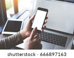 selective focus hand using... | Shutterstock . vector #666897163