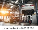 car raised on car lift in... | Shutterstock . vector #666932353