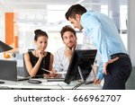 young businesspeople working... | Shutterstock . vector #666962707