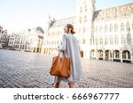 young female tourist walking on ... | Shutterstock . vector #666967777