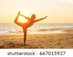 woman is doing yoga exercise at ... | Shutterstock . vector #667015927