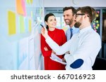 three colleagues working... | Shutterstock . vector #667016923