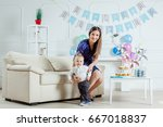 a mother and her son celebrate... | Shutterstock . vector #667018837