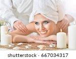 young woman having massage | Shutterstock . vector #667034317