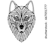 hand drawn wolf with ethnic... | Shutterstock .eps vector #667051777