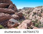 Hikers Among Boulders In Red...