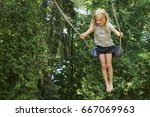 Little child blond girl having...