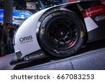 Small photo of SAO PAULO, BRAZIL - NOVEMBER 14, 2016: Close up of the front wheel of the Audi R18 e-tron Quattro 24h Le Mans car displayed inside Audi pavilion at 2016 Sao Paulo International Motor Show.