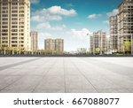 asphalt road and modern city | Shutterstock . vector #667088077