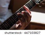closeup of a man's hand playing ... | Shutterstock . vector #667103827