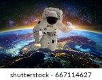 astronaut in galaxy. elements... | Shutterstock . vector #667114627