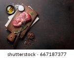raw ribeye beef steak cooking... | Shutterstock . vector #667187377