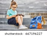 pupil of primary school with... | Shutterstock . vector #667196227