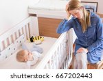 mother trying to put her baby... | Shutterstock . vector #667202443