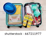 hat and slippers on packed... | Shutterstock . vector #667211977
