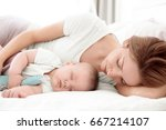 young woman with cute baby... | Shutterstock . vector #667214107