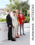 Small photo of AJ Lewis, Alex Sharp, Elle Fanning and John Cameron Mitchell attend the 'How To Talk To Girls At Parties' Photocall during the 70th Cannes Film Festival at Palais on May 21, 2017 in Cannes, France.