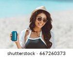 beautiful young woman in... | Shutterstock . vector #667260373