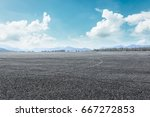 asphalt road and mountain... | Shutterstock . vector #667272853