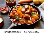 beef meat stewed with potatoes... | Shutterstock . vector #667283557